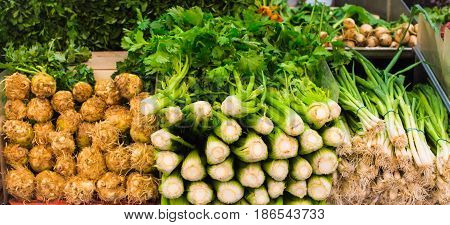 Fresh celery and spring onions in a market as a natural food background