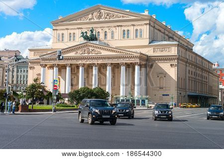 Moscow, Russia - 16 August 2016: Bolshoi Theater, Ohotniy Ryad street. The most famous theatre of Russia. Thousands of tourists annually visit the theatre in Moscow. Cars in front of the theater.