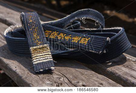 old shabby black belt of kyokushinkai karate