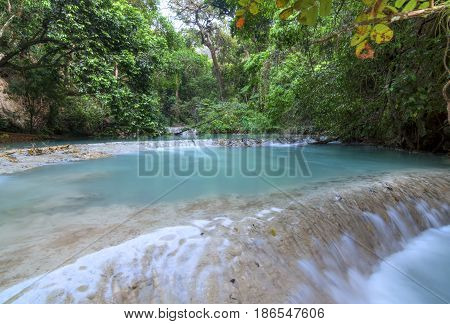 Beautiful pools of cascading turquoise blue water and dense tropical vegetation above La Conchuda waterfall in Rio la Venta Canyon in Chiapas Mexico