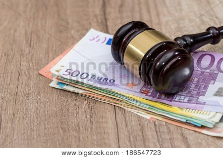 Judge Gavel With Euro  Cash Money And Book On Desk.