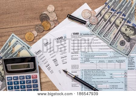 Closeup Of Us Tax Form And Us Money With Calculator, Coin.