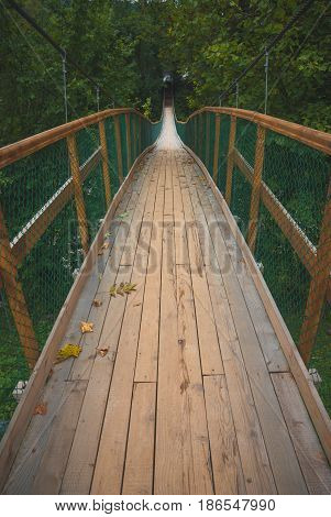 Wooden Suspension Bridge Over The River