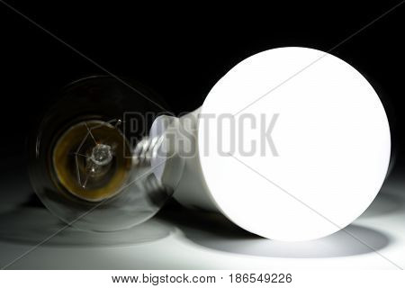 Glowing Led Lamp And Incandescent Bulb In The Dark