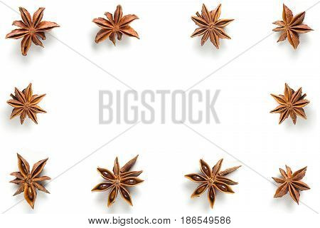 Star anise close-up in the form of a frame, isolated on white background