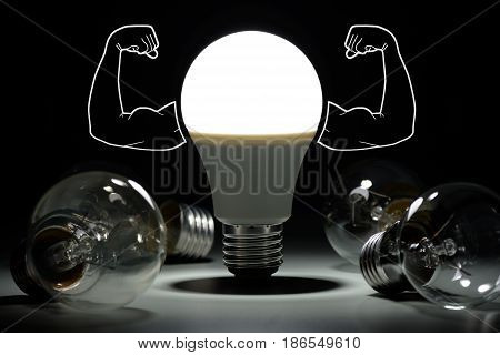 Led Light Bulb With Inflated Arms And Lay Next To Incandescent Bulbs In The Dark
