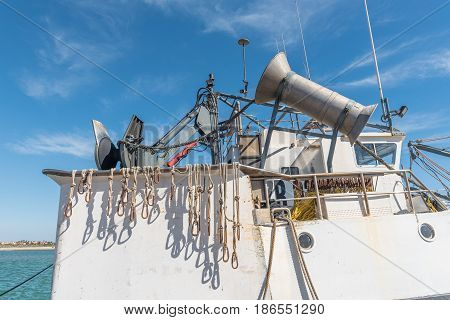 LAAIPLEK SOUTH AFRICA - APRIL 1 2017: Close-up of fishing equipment on a fishing trawler in the harbor in the mouth of the Berg River at Laaiplek on the Atlantic coast of South Africa