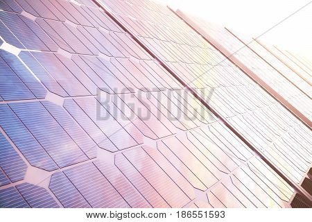 3D illustration solar power generation technology. Alternative energy. Solar battery panel modules with scenic sunset with blue sky with sun light