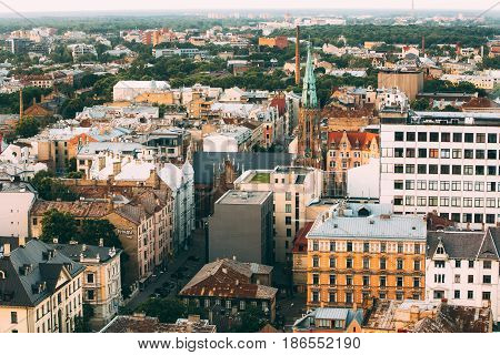 Riga, Latvia - July 2, 2016: Riga Cityscape. Top View Of Baznicas Street In Sunny Summer Evening. St. Gertrude Old Church, Riga. Lutheran Church