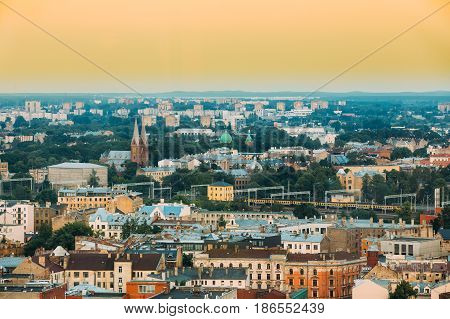 Riga, Latvia - July 2, 2016: Riga Cityscape. Top View Of Landmarks - St. Francis Church And All Saints Church. Aerial View Of Landmarks In Sunset Of Summer Evening