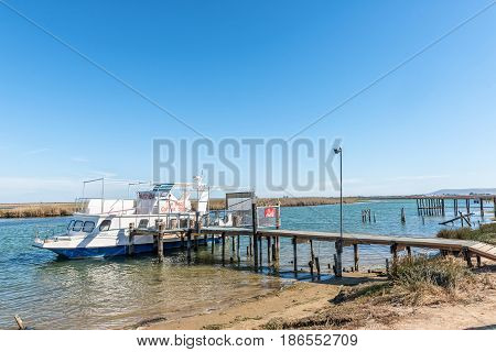 VELDDRIF SOUTH AFRICA - APRIL 1 2017: A coffee shop on a boat at a jetty on the Berg River on Bokkom avenue in Velddrif
