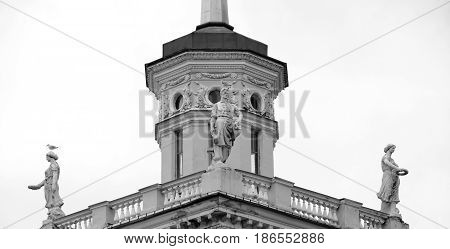 The building is in the style of Stalin in Kolpino outskirts of St. Petersburg Russia. Black and white.