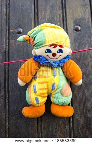 Rag doll on clothesline in front of yard gate
