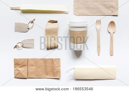 paper bags for food delivery on restourant white table background top view mockup