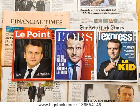 PARIS FRANCE - MAY 10 2017: Le Point L'Express L'Obs above multiple international newspapers front page covers with the picture of the newly elected French president Emmanuel Macron the 8th President of France