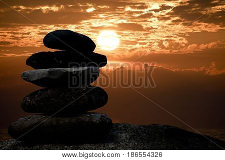 cairn stone silhouette on sunset sky over Lake Michigan