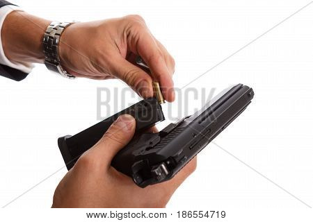 Two hands reloading a handgun on white background