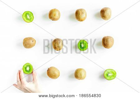 exotic fruit pattern with sliced fresh kiwi on white table background top view