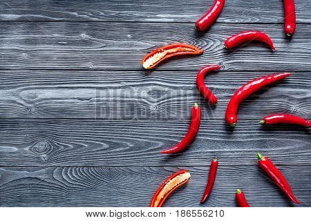 red hot chili pepper frame design on dark wooden table background top view mock-up
