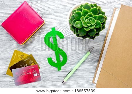online pay for fee-paying education on gray wooden student desk background top view mock up