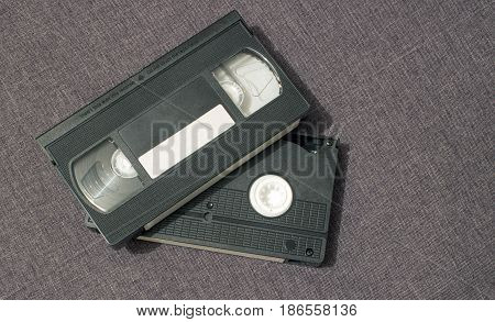 Two video cassettes lie one on top of another
