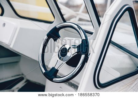 Steering wheel boat, yacht, ship. Expensive finish. Concept travel on water, sea on a yacht.