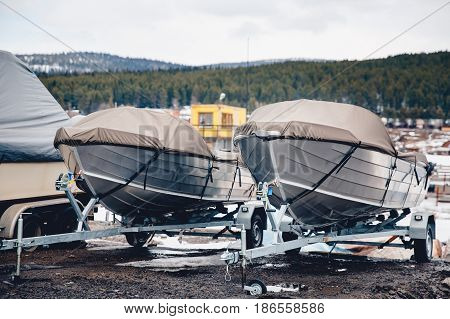 shrink wrapped power boat in autumn woods
