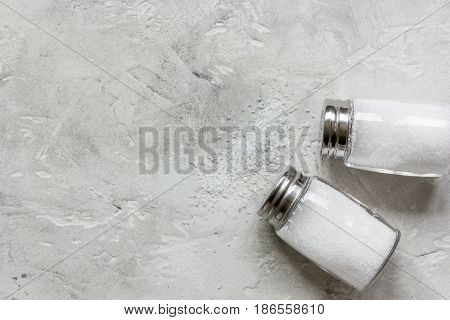 salt in glass bottle on gray kitchen table background top view space for text