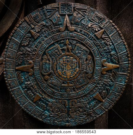 Bronze ancient antique classical Aztec calendar round ornament pattern decoration design background. Aztec abstract texture fractal pattern background. Mexican Aztec calendar bronze effect Axtec art