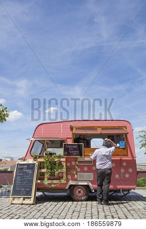 Merida Spain - May 14 2017: Costumer hesitating what choose at Food Truck Festival of Merida Extremadura Spain
