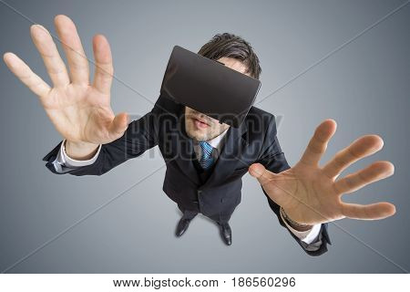 Young Man Is Wearing Virtual Reality Headset. View From Top.