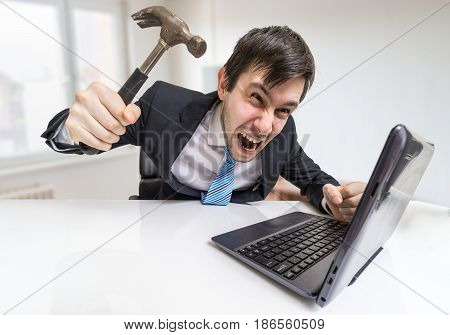 Angry And Crazy Man Is Working With Laptop. He Is Going To Damag