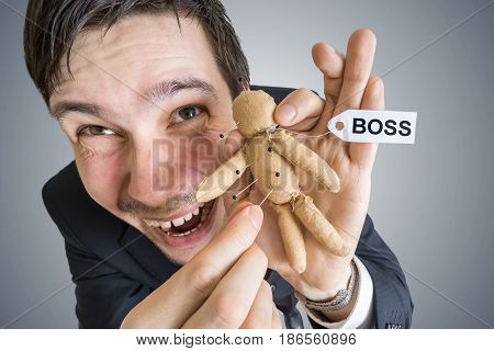 Revenge Concept. Young Employee And Voodoo Doll With Boss Label.