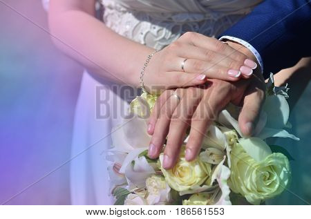 The Newlywed Couple Is Holding A Beautiful Wedding Bouquet. Classical Wedding Photography, Symbolizi