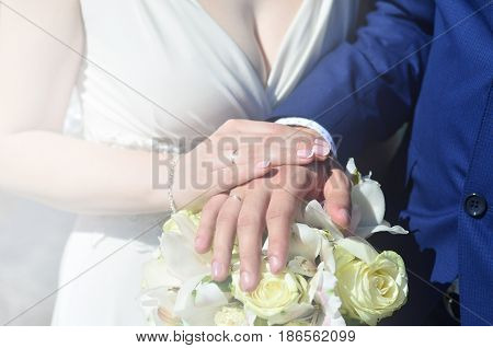 The Newlywed Couple Is Holding A Beautiful Wedding Bouquet. Classical Wedding Photography, Symbolizi
