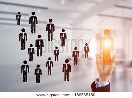 Hand of businesswoman touching glowing icon on screen and office at background