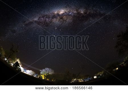 Camping under starry sky and Milky Way arc with details of its colorful core outstandingly bright captured in Southern Africa. Adventure into the wild.