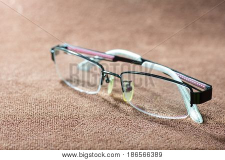 Close-up a glasses on brown garment. selective focus and with a very shallow depth field.