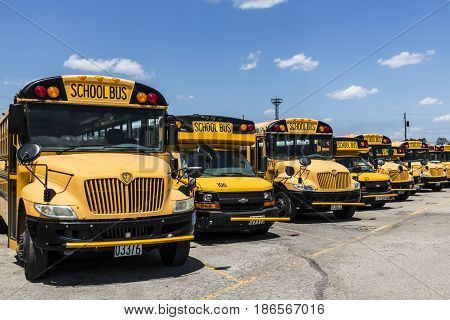 Cincinnati - Circa May 2017: Yellow School Buses in a District Lot Waiting to Depart for Students III