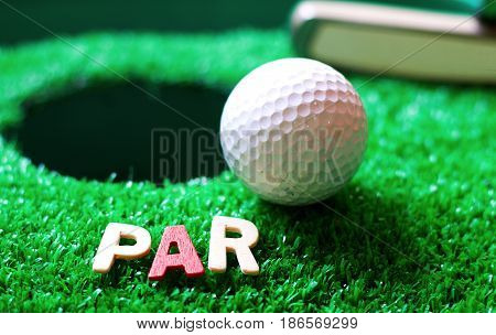 PAR of golf word with golf ball on green grass