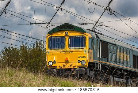 ST ALBANS UK - MAY 2 2017: British cargo train in motion on the railway