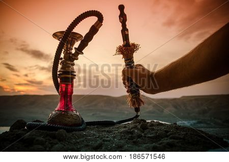 Hookah, Traditional Arabic Waterpipe, Direct Sunset Light, Outdoor Photo