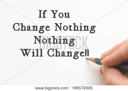 Inspiring motivation quote handwritten on a notepad If You Change Nothing, Nothing Will Change. White pad paper image.