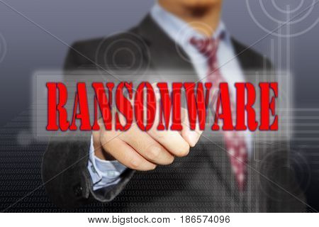 Hand of a businessman clicking Ransomware virus button on virtual screen