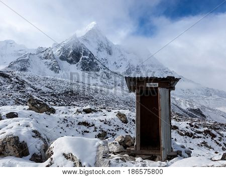 Outdoor Toilet In Himalayas Mountains. Unusual And Funny Outdoor Toilet Location In Snowy Mountains