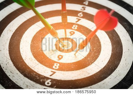 dart arrow hitting in the target center of dartboardabstract of success