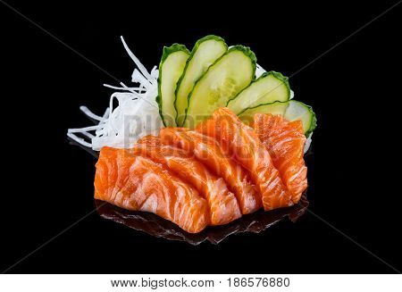 Salmon sashimi over black background Japanese cuisine
