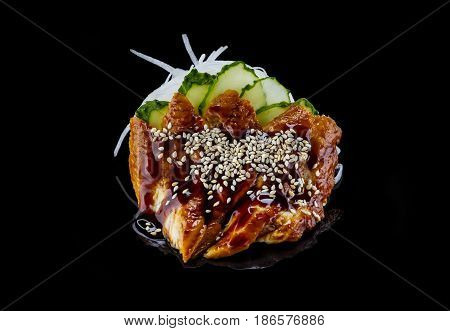 Smoked eel sashimi over black background japanese cuisine