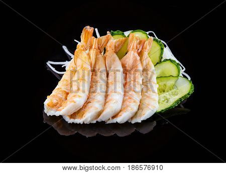 Shrimp sashimi over black background Japanese cuisine