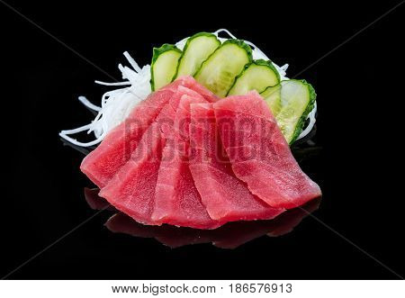 Tuna sashimi over black background japanese cuisine
